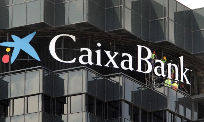 El banco presidido por isidre fain se consolida con esta for Oficinas caixabank madrid