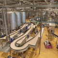 The interior of the brewery. The conveyor line for bottling of beer